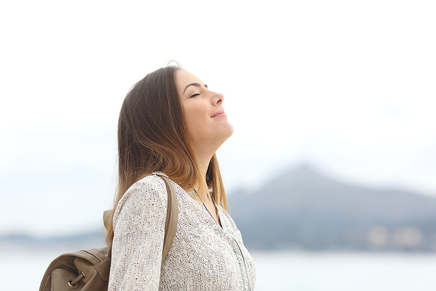 Profile of woman smiling with eyes closed